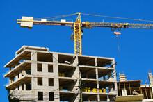 Construction Site.  Self-erection Crane Near Building. Industrial Background.