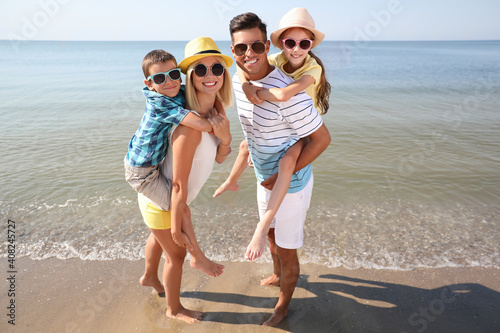 Happy family at beach on sunny summer day