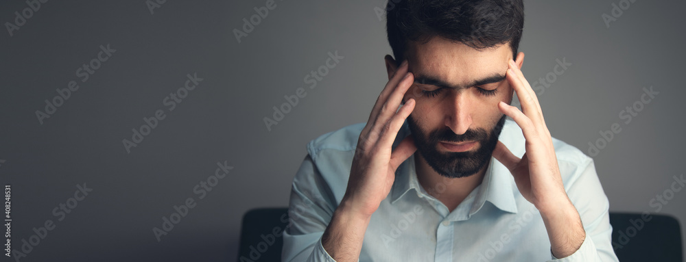 Fototapeta thinking young man hand in head