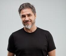 Portrait Of Happy Older White Man, Beard Gray Hair, Smiling. Gray Background,