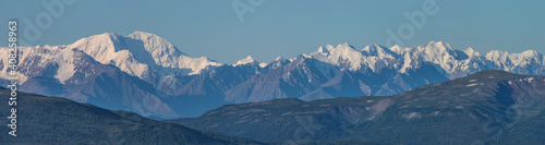 Canvas Print Large panorama. View of the snow-capped mountain range.