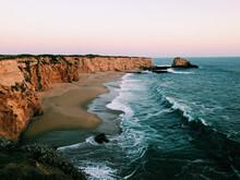 Waves Crashing Beneath The Cliffs
