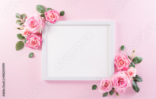 Obraz Happy women's day concept, pink roses with white picture frame on pastel background - fototapety do salonu