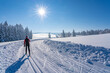 beautiful active senior woman cross-country skiing in fresh fallen powder snow in the Allgau alps near Immenstadt, Bavaria,