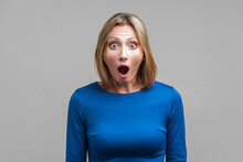 Wow, I Can't Believe This! Portrait Of Astonished Woman With Stunned Shocked Face. Indoor Studio Shot Isolated On Gray Background