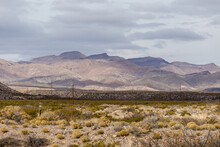 Rolling Hills And Cloudy Skies Behind A Vast Desert Vista Landscape In Rural New Mexico