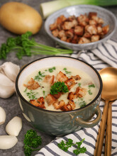 A Bowl Of Fresh Creamy Garlic Soup Top With Bread Croutons, With Ingredients As Potatoes, Leek And Parsley. Garlic Has Natural Antibiotic, Antiviral, Bacteria Properties And A Lot Of Health Benefit