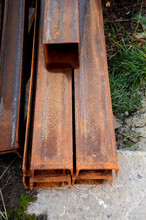 Rusty Metal Pipes Outdoors, Vertical Photo. Construction Concept
