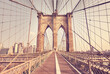 Retro color toned picture of Brooklyn Bridge, New York City, USA.