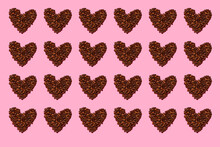 Pattern Of Roasted Coffee Beans Arranged Into Heart Shapes