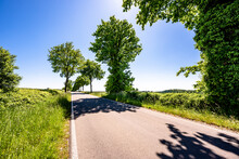 Germany, Mecklenburg-Western Pomerania, Empty Asphalt Road Through Schaalsee Biosphere Reserve In Summer