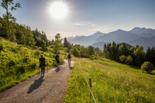 Hikers Hiking On Mountain At Lake Idro, Lombardy, Italy