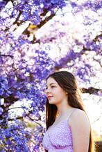 Teen Girl Profile Portrait With Bokeh Purple Jacaranda Flowers In Background