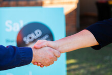 Handshake In Agreement And Congratulations On House Purchase And Sale