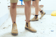 Tradesman Wearing Boots On Construction Site