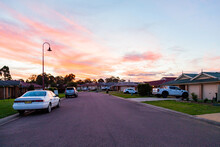 Pastel Sky At Sunset Looking Along Street With Brick Houses In Singleton