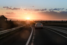 Sunrise On The Highway, Following A Truck And Sedan