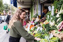 Young Woman Shopping At Greengrocer