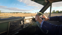 Man Driving A Classic Car (1968 Holden Kingswood HK) In The Country