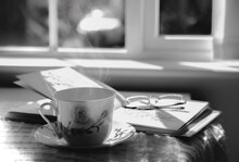 High Key Light Hot Tea With Steaming In Black And White, Still Life Cuppa Tea With Steam On A Coffee Table With Morning Light Shining From Window, Cozy Scene Of Relaxing In Afternoon In Tearoom