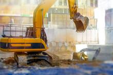 Excavators Digging On Site In City