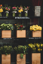 Colourful Flowers Displayed In Wooden Boxes On A Stand