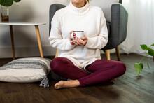 Cozy Woman Enjoys Coffee On The Floor