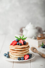 Classic American Pancakes With Fresh Berry On White Wood Background. Summer Homemade Breakfast.