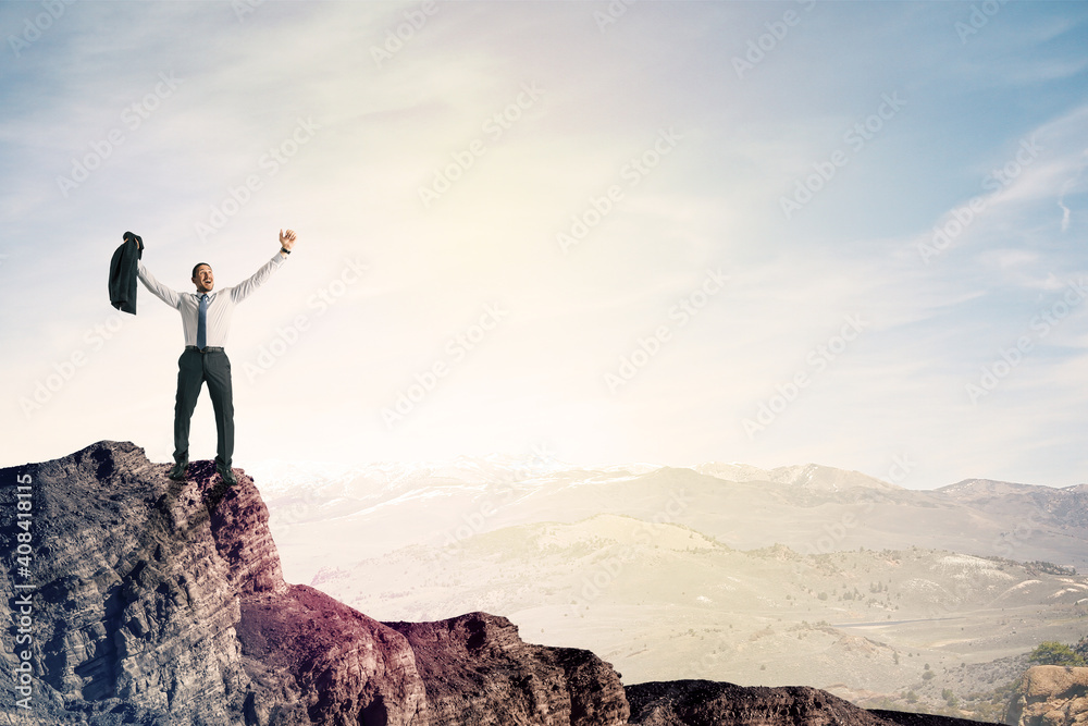 Fototapeta Happy businessman on cliff