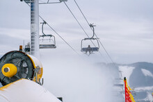 Snow Cannon Throwing Producting Snowon Slope, Snowmaker In Action At Ski Resort