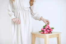 Female Hands With Tulips, The Florist Makes A Bouquet. High Quality Photo