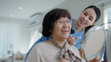 Attractive Young Senior Asian Female Citizen Happy Face With Nurse At Home In Morning In Routine Lifestyle, Hair Brush Combing, Asia Nursing In-home Care Volunteer, Assisted Living Service Concept.
