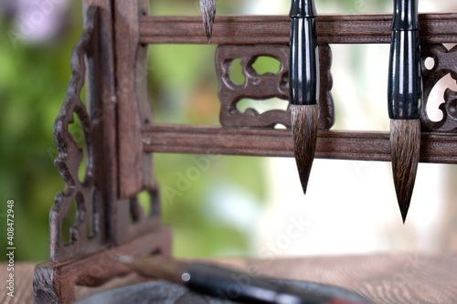 Fototapeta Close up of the brush head hanging upside down on the penholder