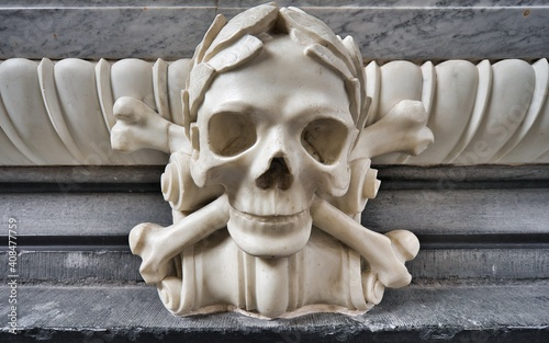 detail (skull) of an ancient coffin in a church or cathedral