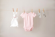 Baby Clothes Hanging On The Rope.