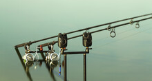 Two Carp Rods On A Stand In The Water