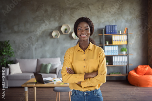 Canvas Print Photo of happy afro american young woman stand folded hands nice smile in office