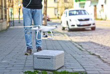 Quadroopter Pilot Manages It By Radio. Man, Guy Beautiful Drone For Photos And Videos And Clearance For His Flights. Photo For Your Design.