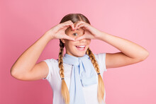 Photo Of Young Girl Happy Positive Smile Gesture Heart Figure Love Valentine Day Isolated Over Pink Color Background