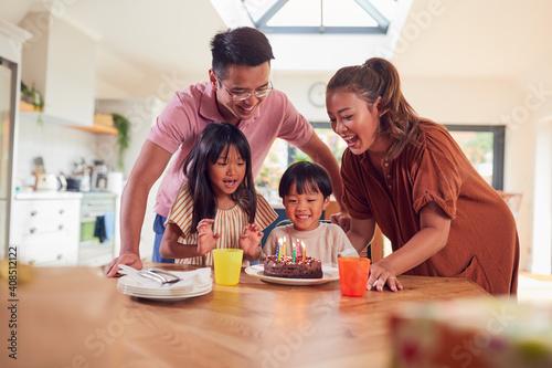 Billede på lærred Asian Family Celebrating Sons Birthday At Home Surprising Him With Candle Covere