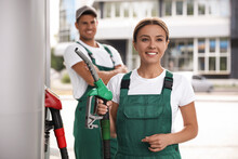 Workers In Uniforms At Modern Gas Station