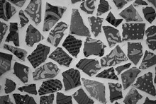 Evocative Black And White Texture Of Irregular Tiles At The Center Of A Flower Design
