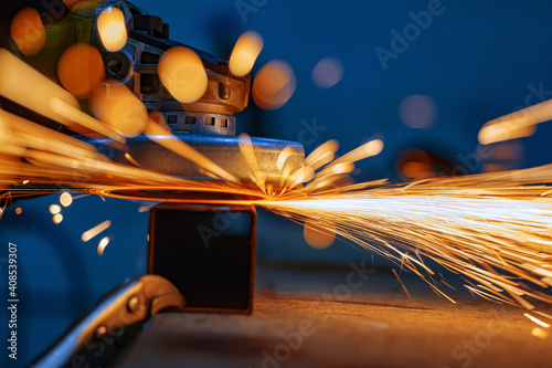 grinding a metal with sparks Fototapeta