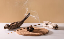 Burning Aromatic Incense Smoky Stick For Meditation And Relaxing On Wooden Minimalistic Background. Aromatherapy Smoke For Yoga Concept.