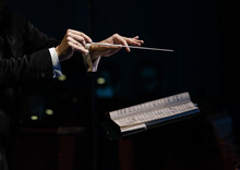 Hands Of The Conductor Of A Symphony Orchestra Closeup