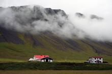 Houses In A Rural Landscape In Near Olavsvik, Iceland.