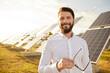 Leinwandbild Motiv Cheerful male investor on solar farm