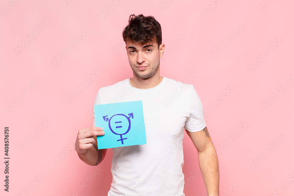 Fototapeta young man feeling sad, upset or angry and looking to the side with a negative attitude, frowning in disagreement