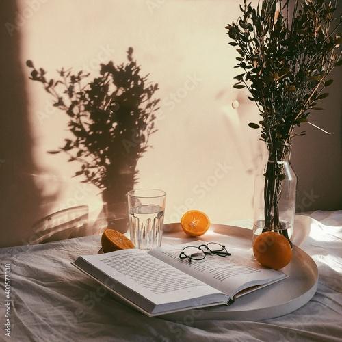 Fototapeta still life with a book and a orange obraz