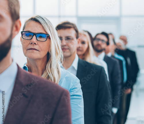 Obraz close up. group of frustrated employees standing in the office. - fototapety do salonu